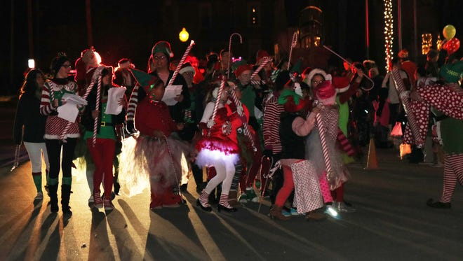 Santa's elves gather to march in Port Clinton's annual lighted Community Christmas parade.