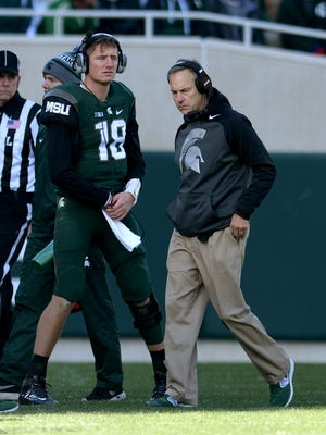 Quarterback Connor Cook and head coach Mark Dantonio are on the sidelines during the second half of the game against Maryland, Saturday, November 14, 2015 at Spartan Stadium in East Lansing.