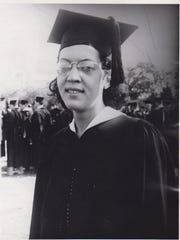 The University of Iowa is looking to name its newest, largest residence hall after sculptor and printmaker Elizabeth Catlett, shown here during her 1940 graduation when she earned a Master in Fine Arts degree.