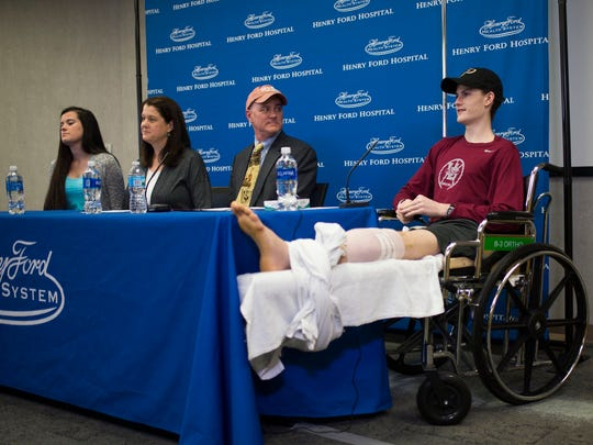 Sean English, 16, on right, speaks during a press conference on Monday, May 1, 2017 at Henry Ford Hospital in Detroit. The heroic University of Detroit Jesuit teen lost his foot after stopping on the side of a highway with his parents last month to assist six crash victims.