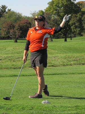 Heather Fortushniak of Brighton tries to coax her tee shot back onto the fairway. She shot 85.