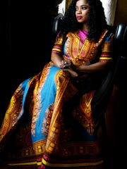 Fashion designer Nimzo Longstratt in one of her dresses.
