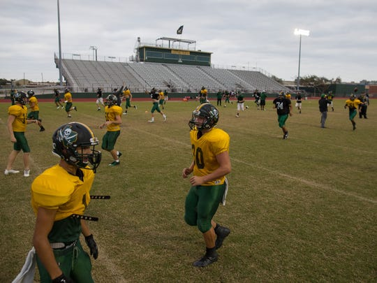 Rockport-Fulton football team warms up at the start of practice at Pirate Stadium in Rockport on Monday, Nov. 21, 2017.