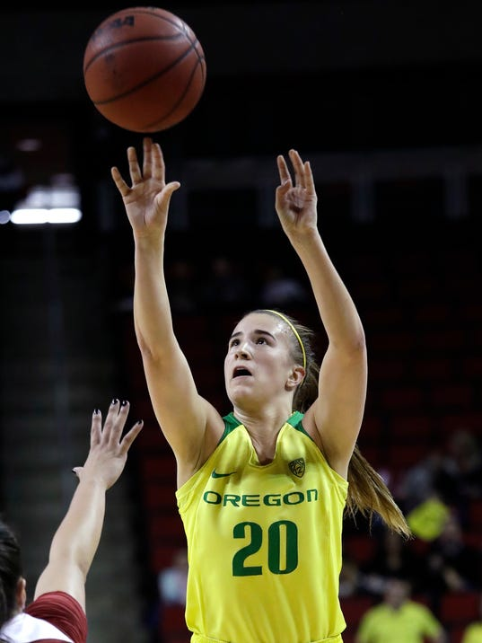 FILE - In this March 4, 2018, file photo, Oregon's Sabrina Ionescu shoots against Stanford during an NCAA college basketball game in the finals of the Pac-12 Conference women's tournament in Seattle. Ionescu was named to the Associated Press women's NCAA college basketball All-America first team, Monday, March 26, 2018. (AP Photo/Elaine Thompson, File)
