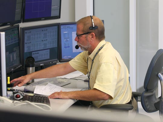 Alan Szydlowski in the control room at the University of Rochester's Omega Laser Facility.