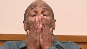 Charles Pierre reacts after his conviction was vacated in 2014.