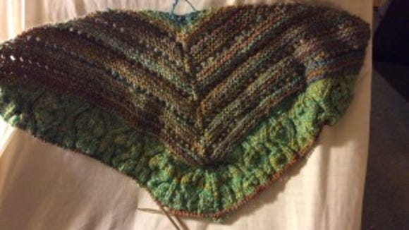 After I ripped out the big brown stripe, I started reknitting it with some milled brown yarn from Miner's Hillside Farm. Sadly, the new yarn is as thin as the old, and I expect I'll be ripping it out and reknitting it doubled. I'm only one-and-a-half rows into it and already, I'm unhappy.