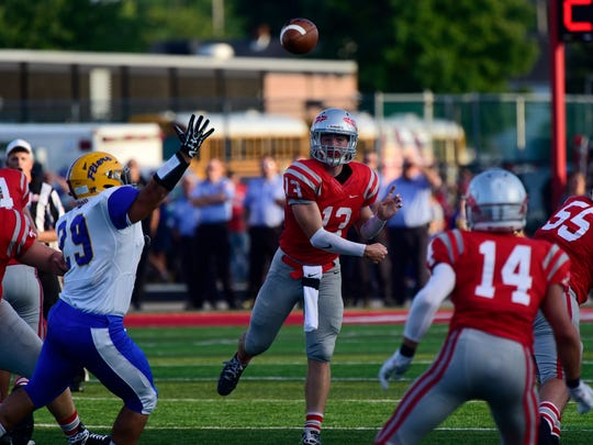 Bellevue's Al Foos throws a pass against Clyde this