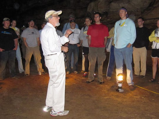 William White, professor emeritus of Penn State and an expert on karst formations, explaining Crump Spring Cave to participants of the Karst Conference in Bowling Green in June 2011.