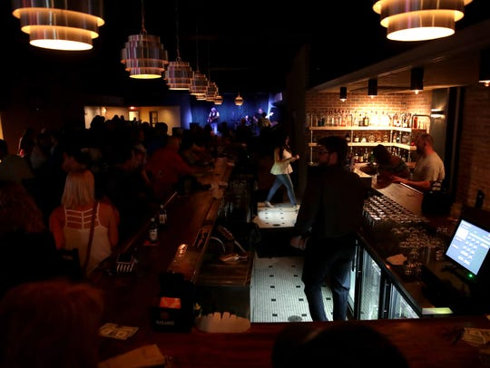 Bartenders work a crowded room at Gibson Music Hall