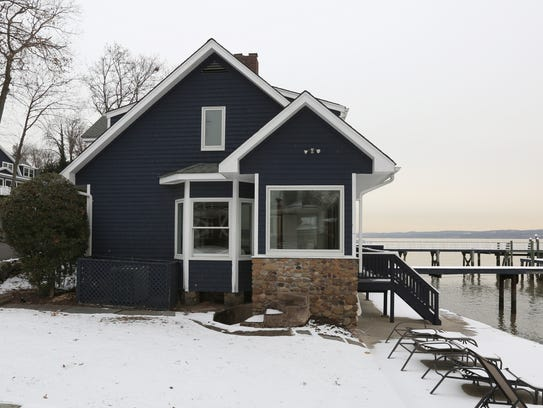 A smaller riverfront home at 2 Washington Ave. is priced at $1.995 million.