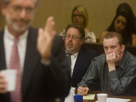 Dale Hausner (right) and his attorney, Tim Agan (center) listen during Prosecutor Vincent Imbordino's (left) opening statements on Oct. 6, 2008, in Maricopa County Superior Court.