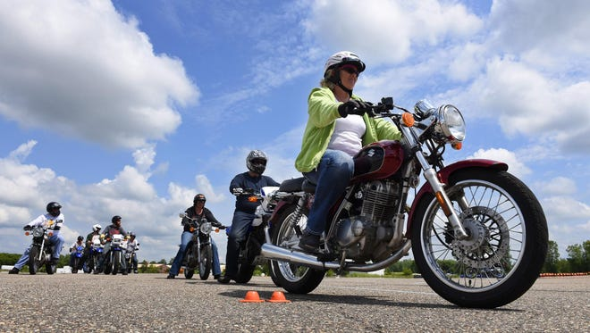 Motorcycle students maneuver through the course working on their skills as they prepare to take their final exam Sunday at the city of St. Cloud Central Maintenance Facility.