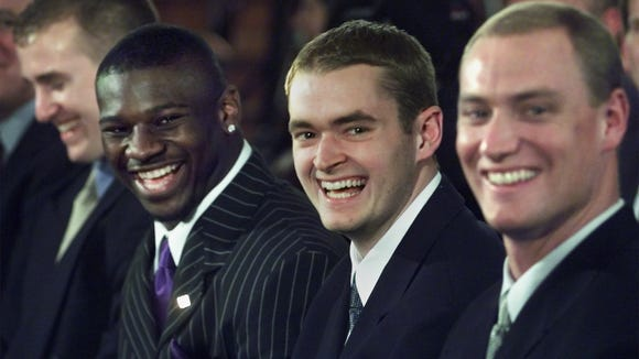 -Heisman Trophy finalists, from left, quarterback Drew Brees, of Purdue, running back LaDainain Tomlinson, of Texas Christian, quarterback Josh Heupel, of Oklahoma, and quarterback Chris Weinke, of Florida State, laugh during the trophy ceremony Saturday, Dec. 9, 2000, at New York's Downtown Athletic Club. Weinke was voted the winner.
