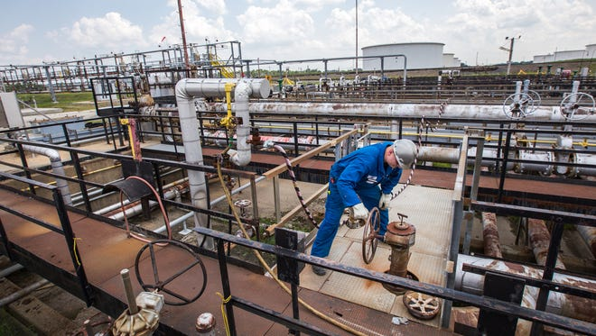 Mike Felker works at the Delaware City Refinery on July 31, 2014.