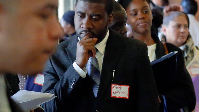 FILE - In this Wednesday Nov. 2, 2016, file photo, job seekers attend a New York Department of Citywide Administrative Services job fair, in New York. On Friday, Dec. 2, 2016, the U.S. government issues the November jobs report. (AP Photo/Bebeto Matthews, File)