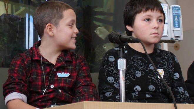 Nine-year-old Jason Rivera, left, and Elijah Martinez, 11, appear at a news conference Nov. 28, 2014, at Westchester Medical Center's Maria Fareri Children's Hospital in Valhalla, N.Y.
