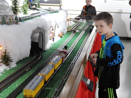 Keil Almroth, 6, of Woodville, watches a model train