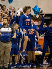 The Cape Coral bench cheers as they take the lead against