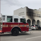 Vehicle catches fire in downtown Vero Beach, leaves burn marks on historic building