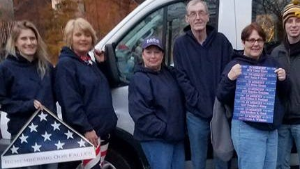 Galva, Ia., resdient Lisa Naslund (center) joined other families of fallen soldiers from Iowa, Illinois and Wisconsin to honor their loved one Friday during the Inauguration Parade in Washington, D.C. Naslund's son, Dillion, committed suicide in December 2012.
