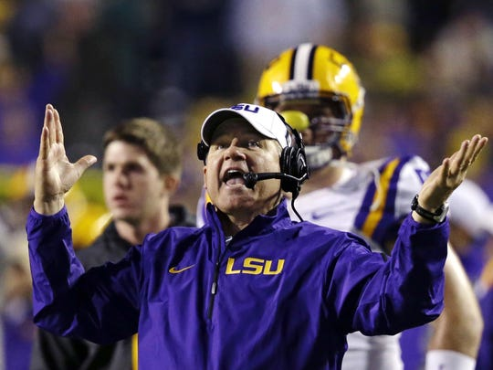 In this Nov. 23, 2013, file photo, LSU head coach Les
