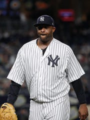 New York Yankees pitcher CC Sabathia walks off the field at the end of the top of the fourth inning of a baseball game against the Baltimore Orioles, Friday, April 6, 2018, in New York.