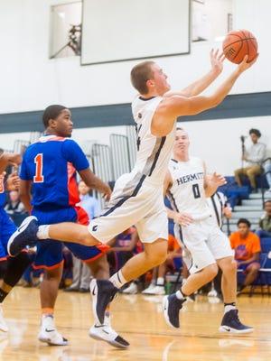St. Augustine Prep's Travis Stoll (24) dives for a basket against Millville at St. Augustine Prep on Thursday, January 26.