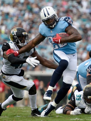 Titans running back Derrick Henry (22) pulls away from a Jaguars defender to score a touchdown in the third quarter Sunday, Sept. 17, 2017, at EverBank Field.