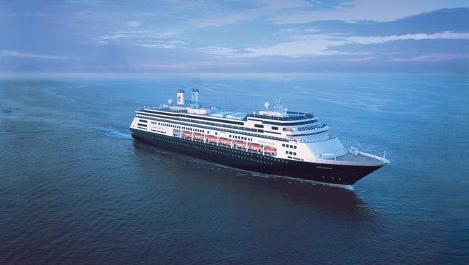 Holland America Line's cruise ship The MS Amsterdam sails through the open ocean.