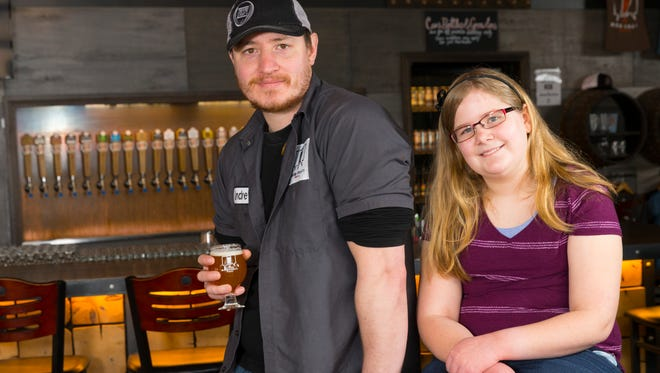 Andrew Gierczak, MobCraft co-founder and head of brewery operations, helped 12-year-old Lyn Sepersky with a school project on brewing.