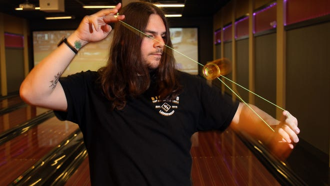 Frank Lombardo, a Landing resident and bartender at the Circle Lanes bar does tricks with a Yoyo Community Spectrum. Lombardo will be competing in the 2017 World Yo-Yo Contest in Reykjav'k, Iceland next weekend. August 2, 2017. Roxbury, NJ