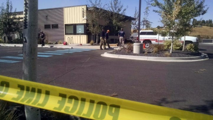 Police seal off a Planned Parenthood clinic in Pullman,