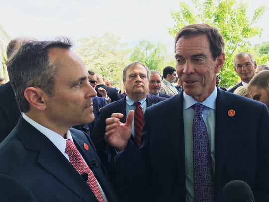 Braidy Industries CEO Craig Bouchard, right, with Gov. Matt Bevin in April 2017 after announcing the aluminum company would spend $1.3 billion to build a plant in Eastern Kentucky.