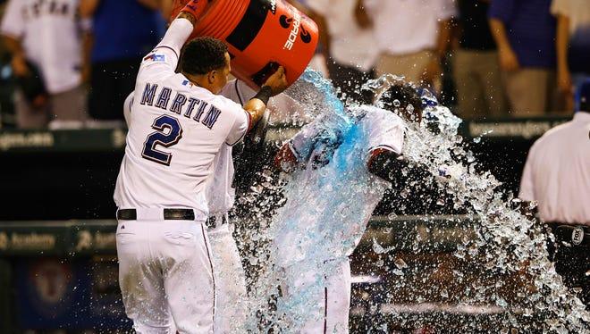 Jurickson Profar gets doused after his walk-off homer.