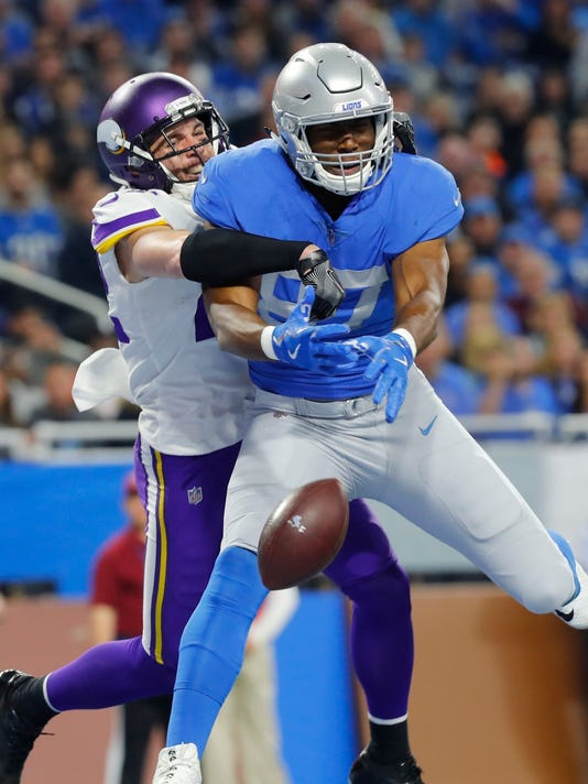 Minnesota Vikings free safety Harrison Smith deflects a pass intended for Detroit Lions tight end Darren Fells (87) during the first half of an NFL football game, Thursday, Nov. 23, 2017, in Detroit. (AP Photo/Paul Sancya)