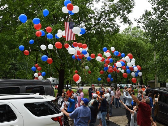 Veterans and volunteers release red, white and blue