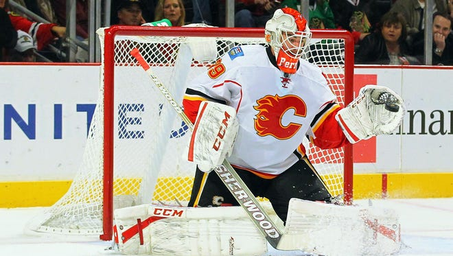 Calgary Flames goalie Reto Berra (29) makes a glove save during the first period against the Chicago Blackhawks at the United Center.