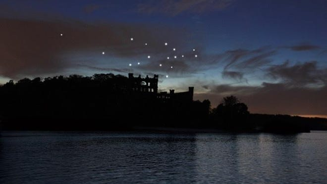 """Melissa McGill's """"Constellation,"""" a large-scale art installation on Bannerman's Island, is shown at night."""