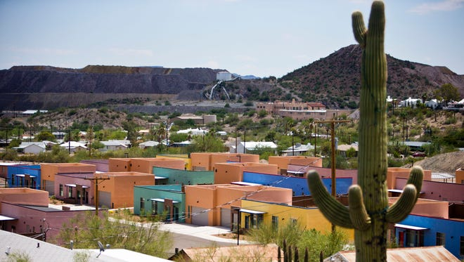 Customs and Border Patrol paid for construction of a two-block cluster of colorful houses in historic Ajo, Ariz.  The federal government spent more than $600,000 each to build 21 houses in Ajo and develop the surrounding area.