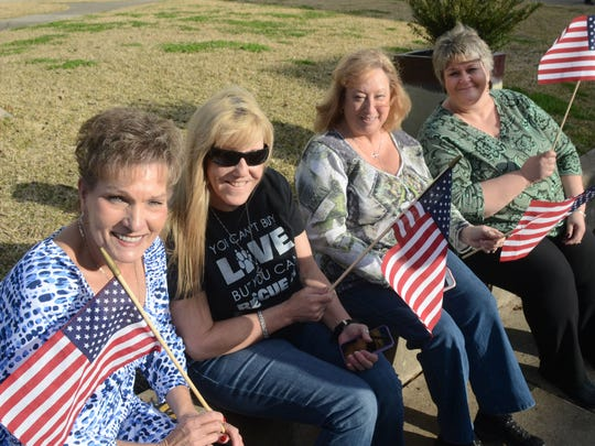 ANI Fort Polk Support Susan Gunter (left) who was born at Camp Polk, Lynn Marshall, Jeannie Orme and Alesia Richardson were among those Leesville community members who came out in support of Fort Polk Sunday, March 3, 2015.-Melinda Martinez/mmartinez@theto