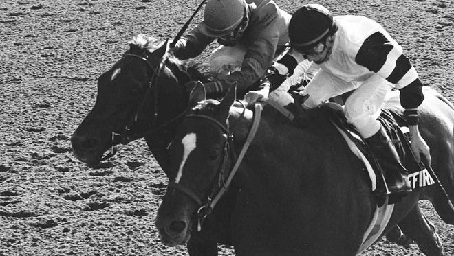 In this June 10, 1978, file photo, Affirmed, Steve Cauthen up, right, battles Alydar, Jorge Valasquez up, down the stretch of the Belmont Stakes at Belmont Park in Elmont, N.Y.