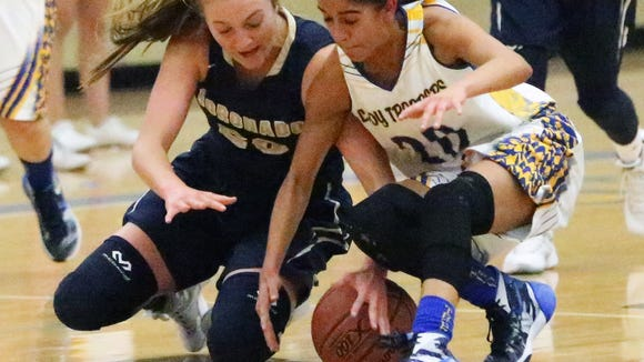 Miranda Vega, right, of Eastwood goes after a loose