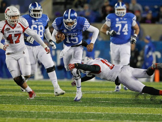 Nov 19, 2016; Lexington, KY, USA; Kentucky Wildcats quarterback Stephen Johnson (15) runs the ball against the Austin Peay Governors in the second half at Commonwealth Stadium. Kentucky defeated Austin Peay 49-13.