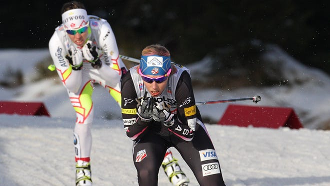 US Kikkan Randall (R) competes during the sprint event of the FIS Cross Country Skiing World Cup 2014 on January 18, 2014, in Szklarska Poreba, Poland. Randall won the competition ahead of Denise Herrmann on the second place and Fabjan Vesna placing third.