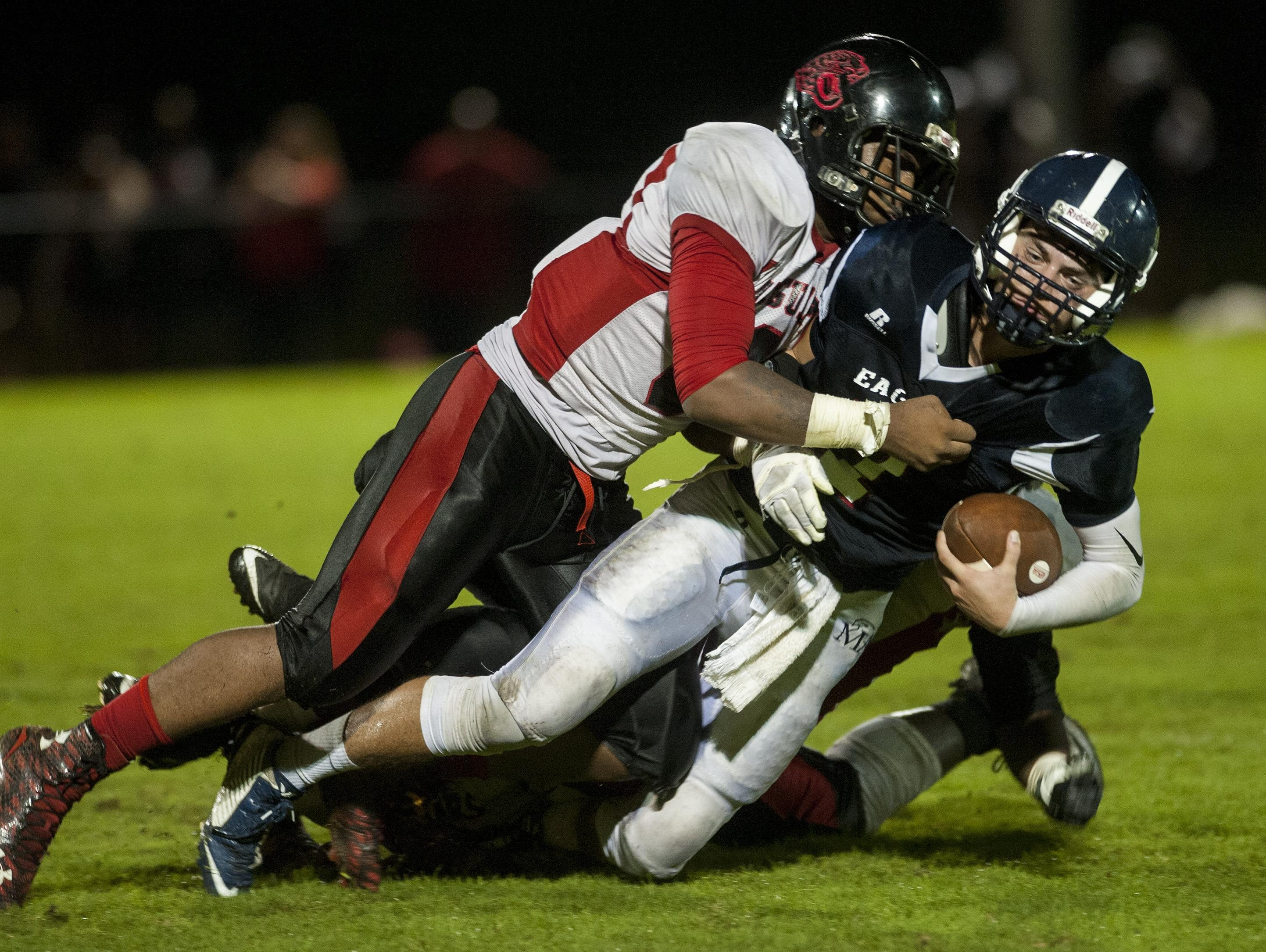 Montgomery Academy quarterback Barton Lester is sacked by Hillcrest defender Rajos Smith at the MA campus in Montgomery, Ala. on Friday November 6, 2015.