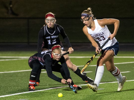 New Oxford's Carly Flickinger runs the ball around