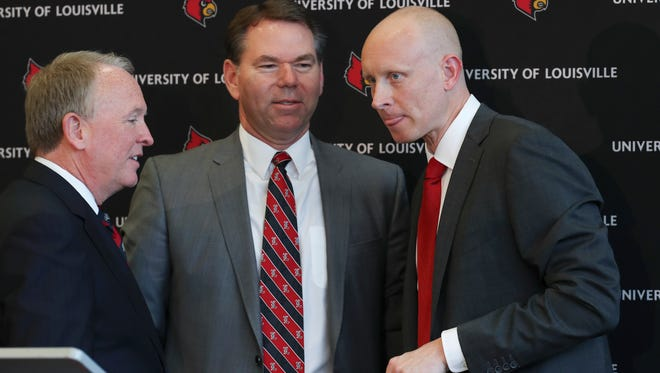 New Louisville basketball head coach Chris Mack, right, chatted with interim president Greg Postel, left, and athletic director Vince Tyra following remarks at the Yum Center.    Mar. 28, 2018