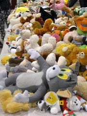 A table filled with stuffed animals in the Toy Shop