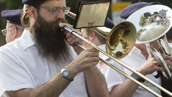 Oshkosh Post 1908 VFW band plays from a wagon in the Oshkosh Fourth of July Veteran's Parade Saturday, July 4, 2015.